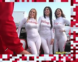 three grid girls pleasing the winning driver